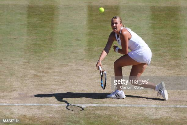 Anett Kontaveit of Estonia in action against Caroline Wozniacki of Denmark on number one court during the Wimbledon Lawn Tennis Championships at the...