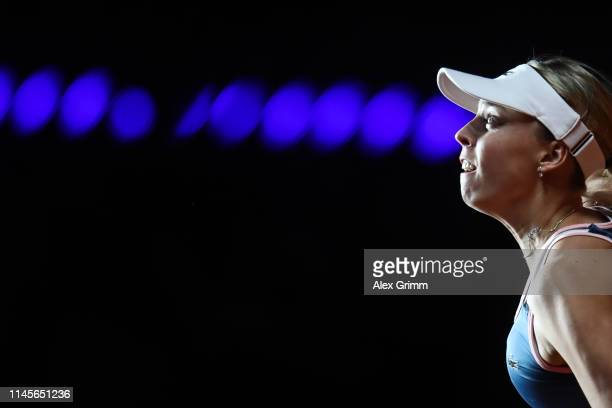 Anett Kontaveit of Estonia looks on as she serves the ball to Petra Kvitova of Czech Republic during their final match on day 7 of the Porsche Tennis...