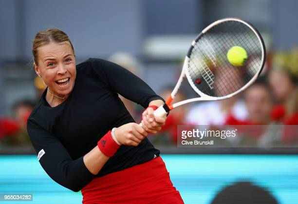 Anett Kontaveit of Estonia plays a backhand against Venus Williams of the United States in their first round match during day one of the Mutua Madrid...