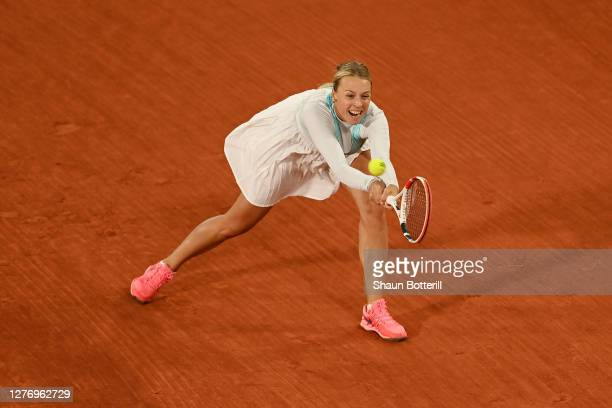 Anett Kontaveit of Estonia plays a backhand during her Women's Singles first round match against Caroline Garcia of France during day one of the 2020...
