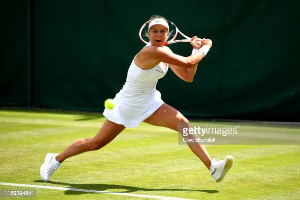 Anett Kontaveit of Estonia plays a backhand in her Ladies' Singles first round match against Shelby Rogers of the United States during Day one of The...