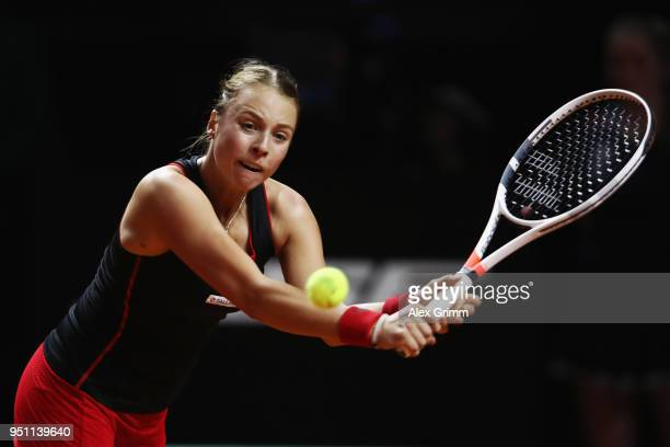 Anett Kontaveit of Estonia plays a backhand to Kristina Mladenovic of France during day 3 of the Porsche Tennis Grand Prix at PorscheArena on April...