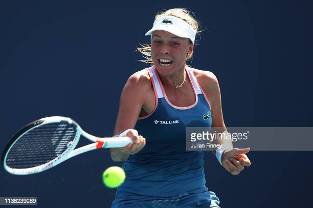 Anett Kontaveit of Estonia plays a forehand in her match against Bianca Andreescu of Canada during the Miami Open Tennis on March 25 2019 in Miami...
