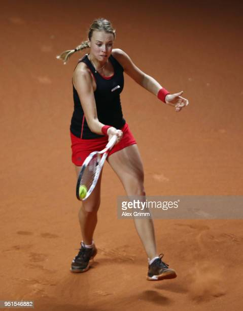 Anett Kontaveit of Estonia plays a forehand to Angelique Kerber of Germany during day 4 of the Porsche Tennis Grand Prix at PorscheArena on April 26...