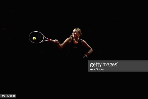 Anett Kontaveit of Estonia plays a forehand to Kristina Mladenovic of France during day 3 of the Porsche Tennis Grand Prix at Porsche-Arena on April...