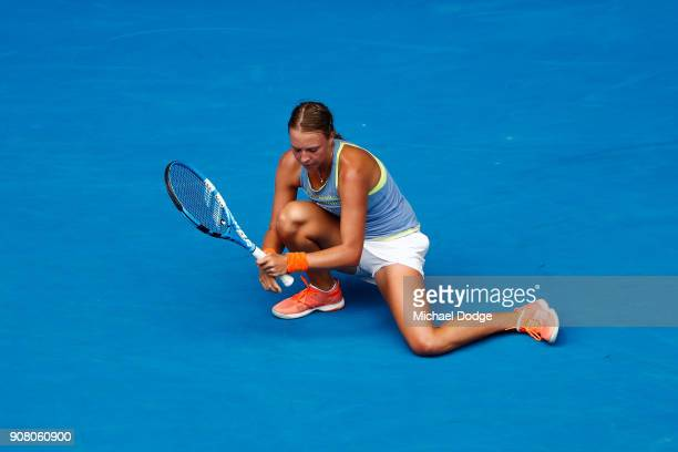 Anett Kontaveit of Estonia reacts after losing a point in her fourth round match against Carla Suarez Navarro of Spain on day seven of the 2018...