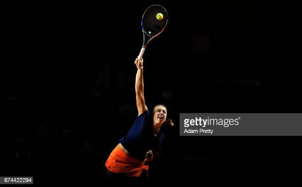 Anett Kontaveit of Estonia serves during her match against Maria Sharapova of Russia during the Porsche Tennis Grand Prix at Porsche Arena on April...