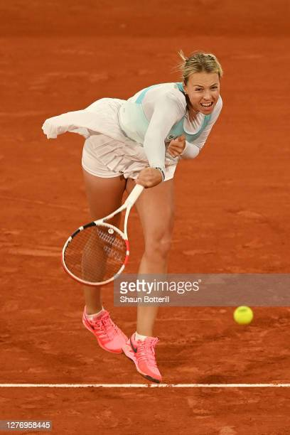 Anett Kontaveit of Estonia serves during her Women's Singles first round match against Caroline Garcia of France during day one of the 2020 French...