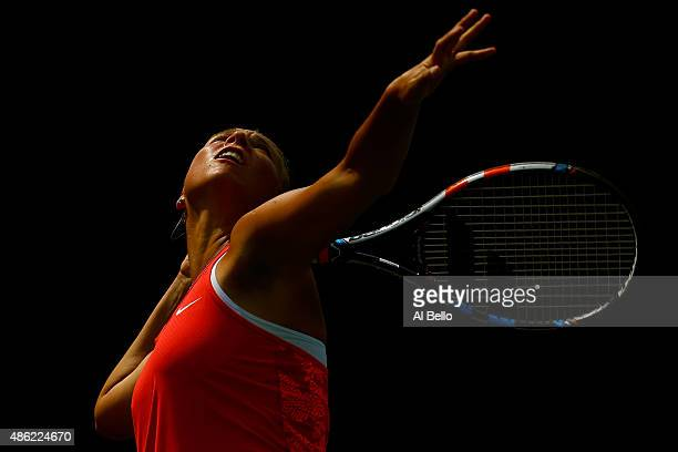 Anett Kontaveit of Estonia serves to Anastasia Pavlyuchenkova of Russia during their Women's Singles Second Round match on Day Three of the 2015 US...