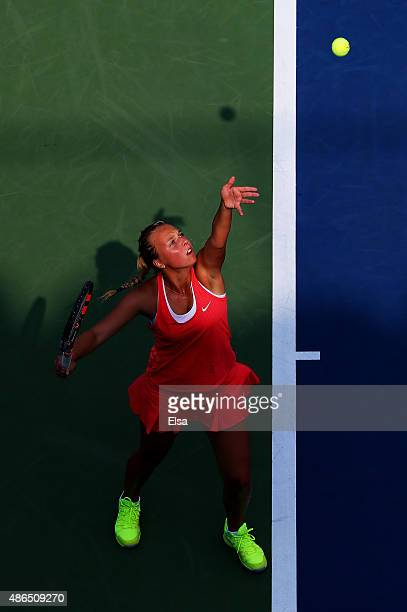 Anett Kontaveit of Estonia serves to Madison Brengle of the United States during their Women's Singles Third Round match on Day Five of the 2015 US...