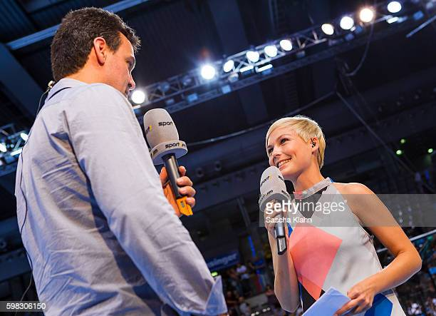 Anett Sattler from Sport1during an interview with former handball world champion Markus Baur at the Pixum Super Cup 2016 between RheinNeckar Lwen and...