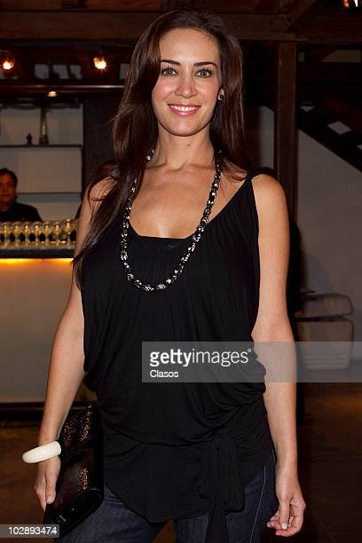Anette Michel poses for a photograph at the red carpet of Cinco Mujeres Usando el Mismo Vestido at Telon de Asfalto Theater on July 13 2010 in Mexico...