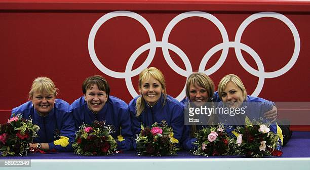 Anette Norberg Catherine Lindahl Anna Svaerd Ulrika Bergman and Eva Lund of Sweden pose after winning gold during the gold medal match of the women's...