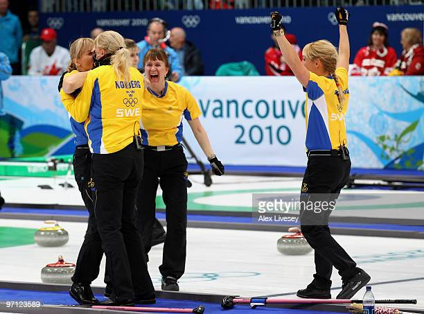Anette Norberg, Eva Lund, Cathrine Lindahl and Anna Le Moine celebrate after victory over Canada in the women's gold medal curling game between...