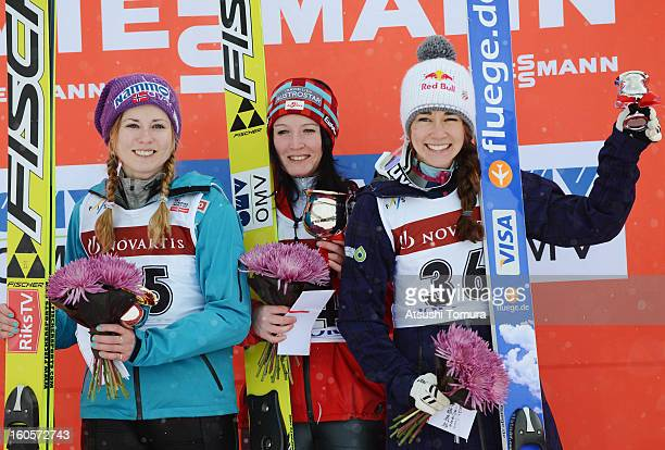 Anette Sagen of Norway Jacqueline Seifriedsberger of Austria Sarah Hendrickson of USA pose on the podium during day two of the FIS Women's Ski...