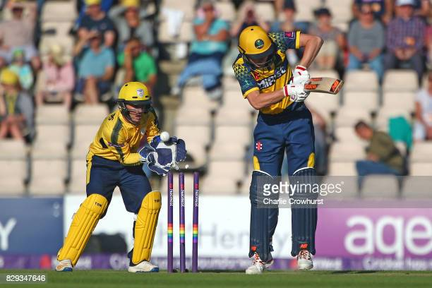 Aneurin Donald of Glamorgan is bowled out while Hampshire wicket keeper Calvin Dickinson celebrates on during the NatWest T20 Blast match between...