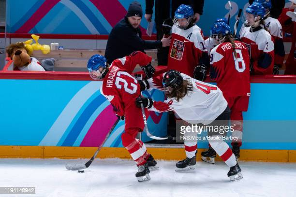 Anezka Hracova of Czech Republic battles for the puck with Alina Marti of Switzerland during Women's 6-Team Tournament Preliminary Round - Group B...