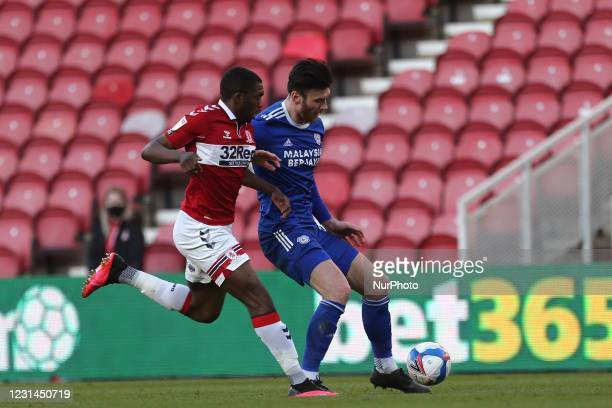 Anfernee Dijksteel of Middlesbrough battles for possession with Cardiff City's Kieffer Moore during the Sky Bet Championship match between...