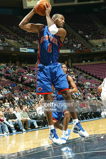 Anfernee Hardaway of the New York Knicks attempts a rebound against the New Jersey Nets on October 26 2004 at the Continental Airlines Arena in East...