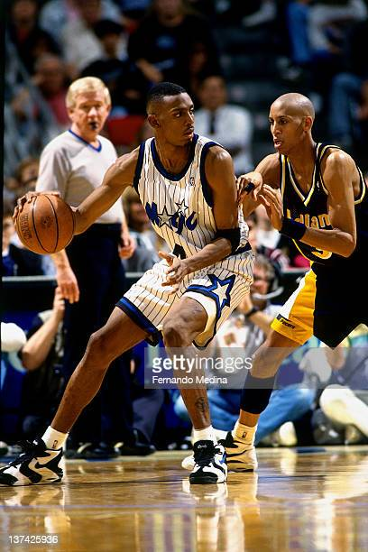 Anfernee Hardaway of the Orlando Magic dribbles against Reggie Miller of the Indiana Pacers circa 1995 at the Orlando Arena in Orlando Florida NOTE...