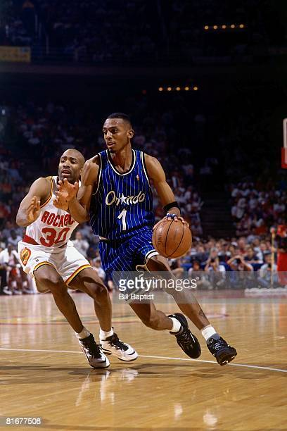 Anfernee Hardaway of the Orlando Magic drives past Kenny Smith of the Houston Rockets in Game Three of the 1995 NBA Finals at the Summitt on June 11...