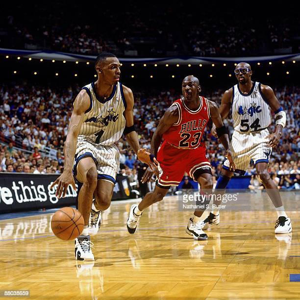Anfernee Hardaway of the Orlando Magic drives to the basket against Michael Jordan of the Chicago Bulls in Game Two of the Eastern Conference...