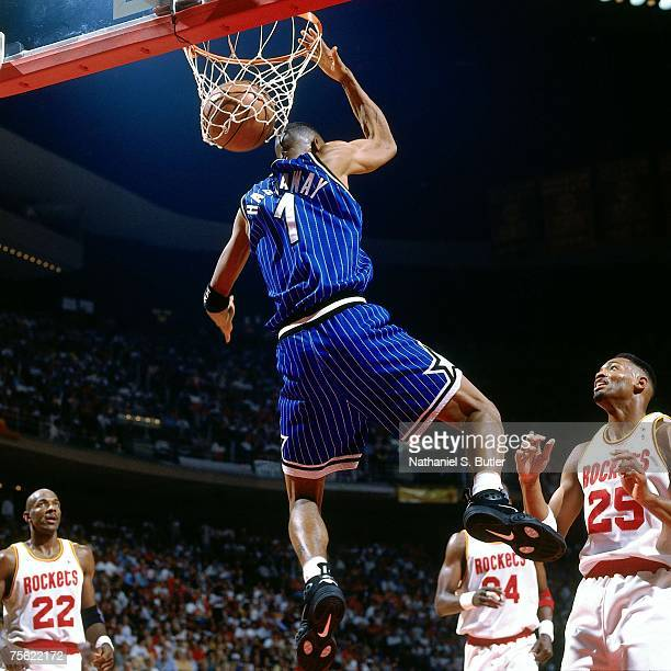 Anfernee Hardaway of the Orlando Magic dunks against Clyde Drexler of the Houston Rockets in Game Four of the 1995 NBA Finals played June 14 1995 at...