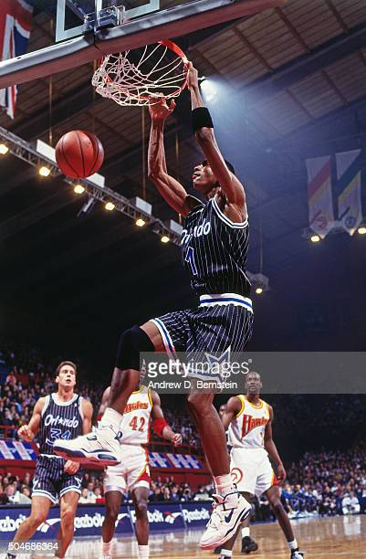 Anfernee Hardaway of the Orlando Magic dunks against the Atlanta Hawks on October 30 1993 in London England NOTE TO USER User expressly acknowledges...