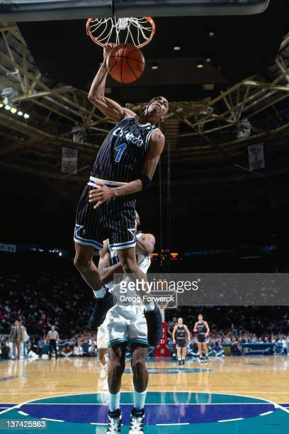 Anfernee Hardaway of the Orlando Magic dunks against the Charlotte Hornets circa 1995 at the Charlotte Coliseum in Charlotte North Carolina NOTE TO...
