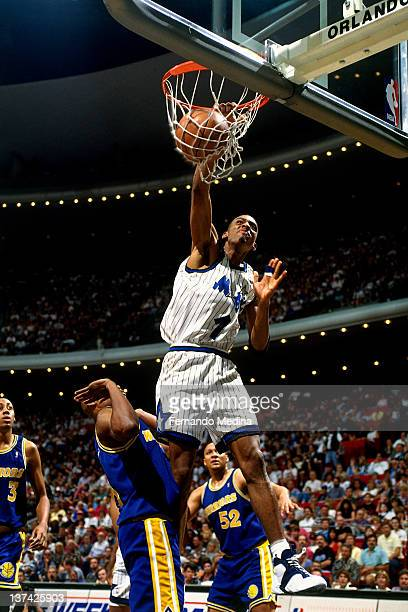 Anfernee Hardaway of the Orlando Magic dunks against the Golden State Warriors circa 1995 at the Orlando Arena in Orlando Florida NOTE TO USER User...