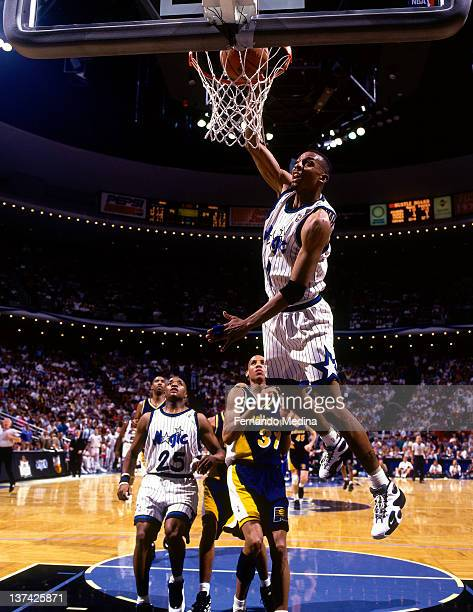 Anfernee Hardaway of the Orlando Magic dunks against the Indiana Pacers circa 1995 at the Orlando Arena in Orlando, Florida. NOTE TO USER: User...