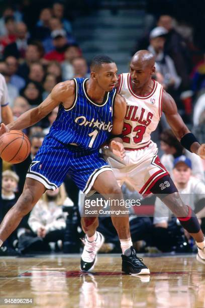 Anfernee Hardaway of the Orlando Magic handles the ball against Michael Jordan of the Chicago Bulls on December 13, 1995 at the United Center in...