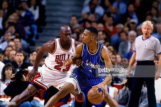 Anfernee Hardaway of the Orlando Magic moves the ball against Michael Jordan of the Chicago Bulls in Game Six of the Eastern Conference Semifinals...