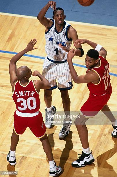 Anfernee Hardaway of the Orlando Magic passes against Kenny Smith of the Houston Rockets during Game One of the 1995 NBA Finals played on June 7 1995...