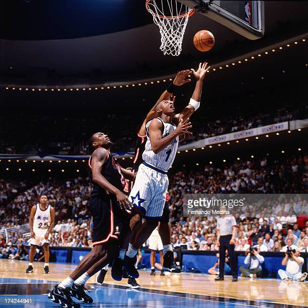 Anfernee Hardaway of the Orlando Magic shoots a layup against Keith Askins of the Miami Heat during Game 3 in Round 1 of the Eastern Conference...
