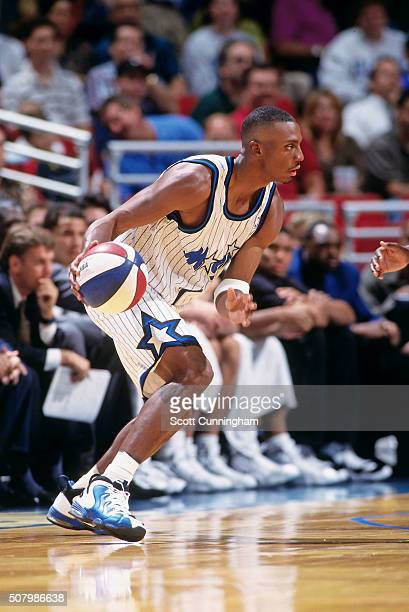 Anfernee Hardaway of the Orlando Magic drives against the San Antonio Spurs during a preseason game on October 14 1997 at the Orlando Arena in...