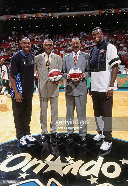 Anfernee Hardaway of the Orlando Magic NBA Legends Julius Dr J ErvingGeorge Gervin and David Robinson of the San Antonio Spurs poses for a photo to...