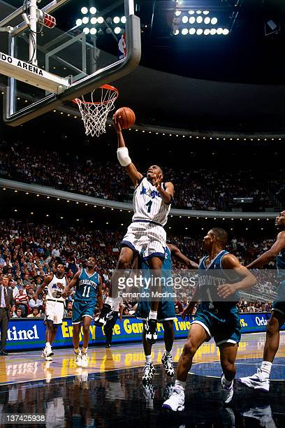 Anfernee Hardaway of the Orlando Magic shoots against Muggsy Bogues of the Charlotte Hornets circa 1995 at the Orlando Arena in Orlando Florida NOTE...