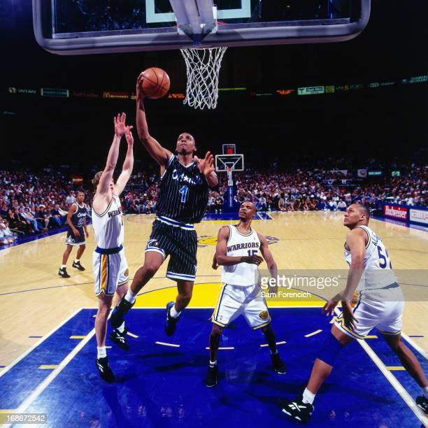 Anfernee Hardaway of the Orlando Magic shoots the ball against the Golden State Warriors circa 1995 at the OaklandAlameda County Coliseum Arena in...