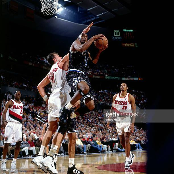 Penny hardaway 1997 stock photos and pictures getty images anfernee hardaway of the orlando magic takes the ball to the basket against arvydas sabonis of sciox Gallery