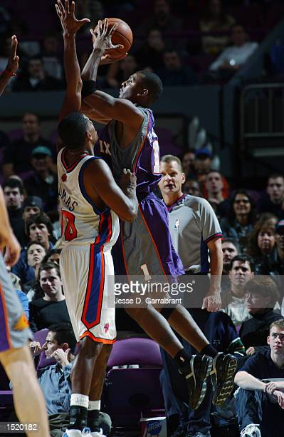 Anfernee Hardaway of the Phoenix Suns goes to the basket against Kurt Thomas of the New York Knicks during the preseason game on October 12 2002 at...
