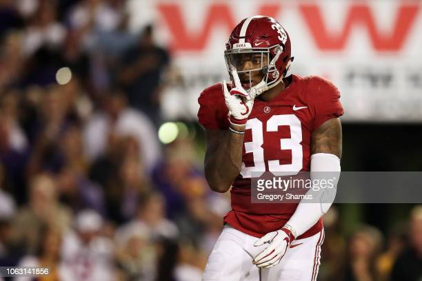 Anfernee Jennings of the Alabama Crimson Tide celebrates sacking Joe Burrow of the LSU Tigers in the second quarter of their game at Tiger Stadium on...