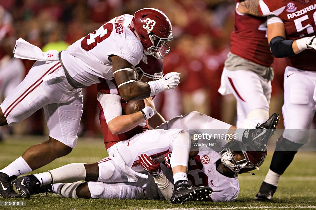 Anfernee Jennings #33 of the Alabama Crimson Tide hits Austin Allen #8 of the Arkansas Razorbacks and is called for roughing the quarterback at Razorback Stadium on October 8, 2016 in Fayetteville, Arkansas. The Crimson Tide defeated the Razorbacks 49-30.