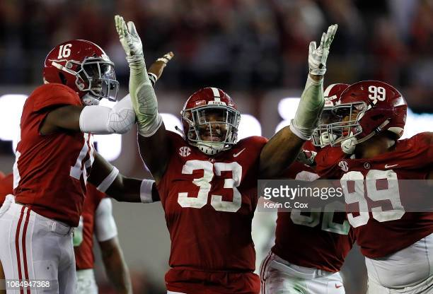 Anfernee Jennings of the Alabama Crimson Tide reacts after intercepting a pass intended for Tucker Brown of the Auburn Tigers at BryantDenny Stadium...