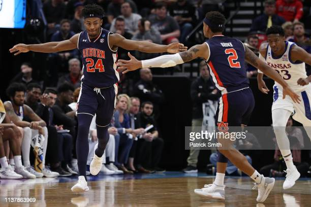 Anfernee McLemore and Bryce Brown of the Auburn Tigers react to a play against the Kansas Jayhawks during their game in the Second Round of the NCAA...