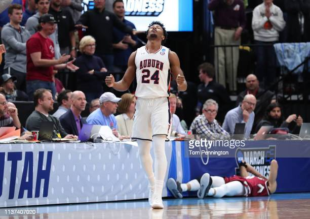 Anfernee McLemore of the Auburn Tigers celebrates after defeating the New Mexico State Aggies 7877 in the first round of the 2019 NCAA Men's...