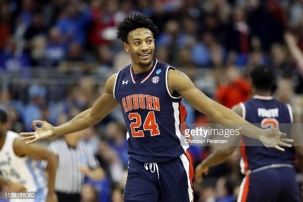 a70f413c3a1 Anfernee McLemore of the Auburn Tigers celebrates against the North  Carolina Tar Heels during the 2019