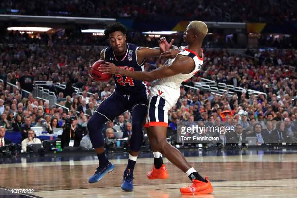 Anfernee McLemore of the Auburn Tigers handles the ball against Mamadi Diakite of the Virginia Cavaliers in the second half during the 2019 NCAA...