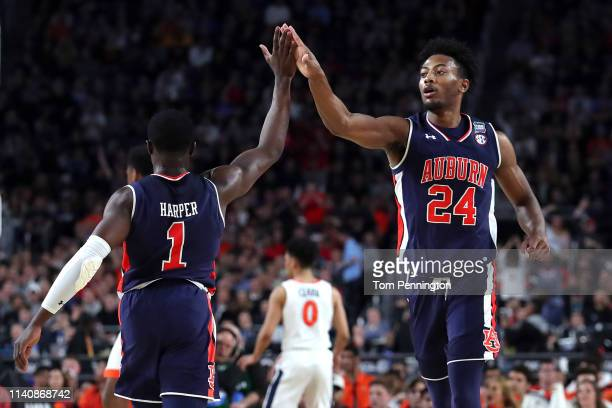 Anfernee McLemore of the Auburn Tigers high fives Jared Harper in the first half against the Virginia Cavaliers during the 2019 NCAA Final Four...