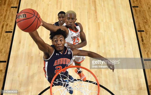 Anfernee McLemore of the Auburn Tigers shoots against Mamadi Diakite of the Virginia Cavaliers during the first half of the semifinal game in the...